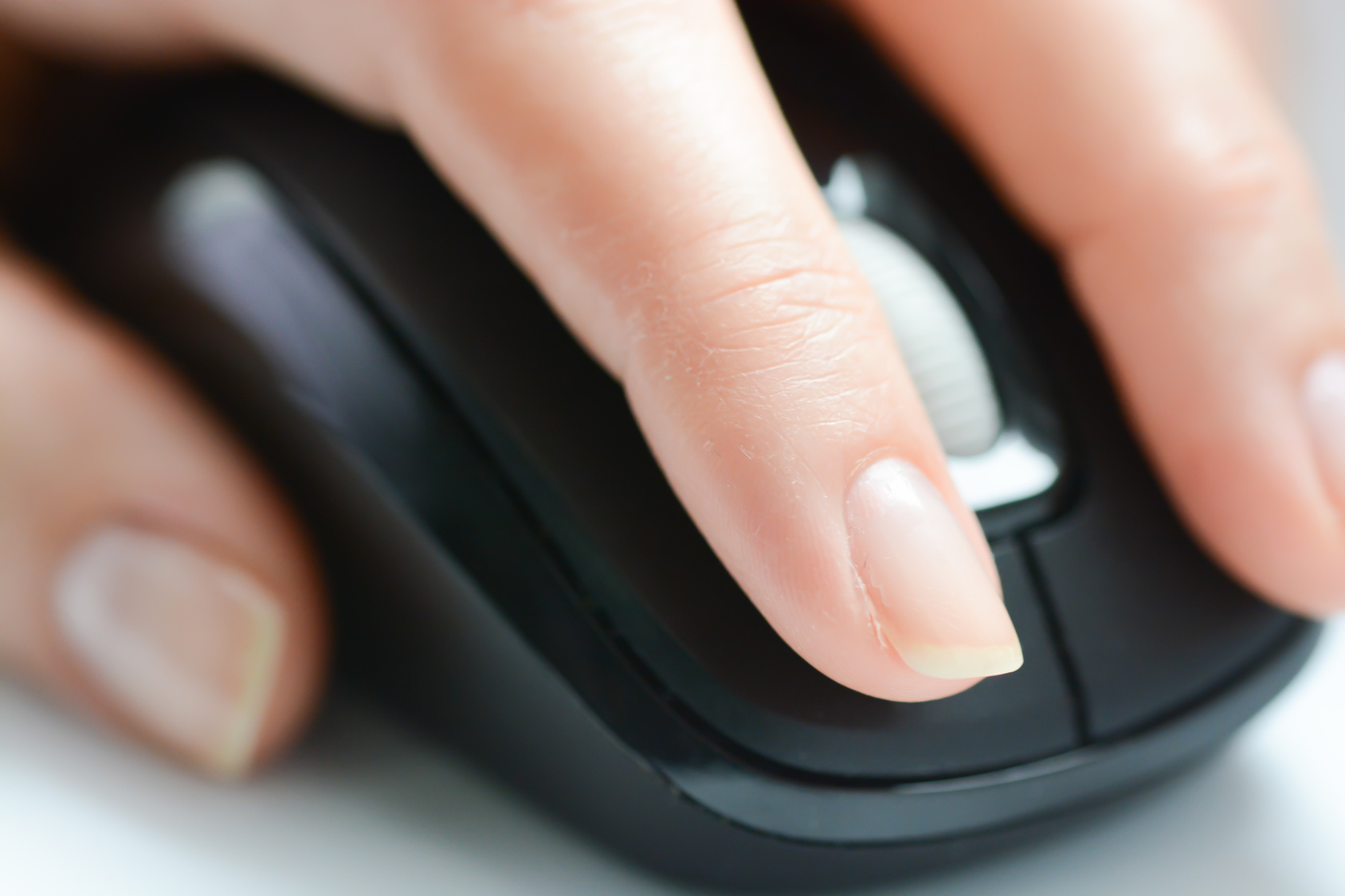 Woman hand on computer mouse