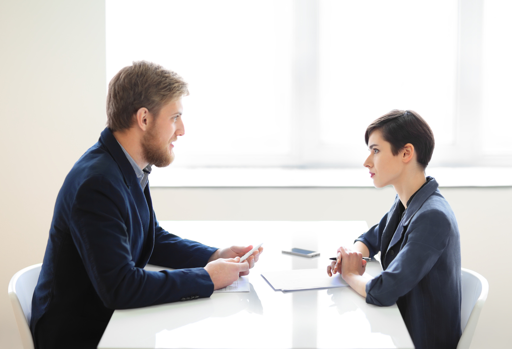Businessman and businesswoman having interview in the office